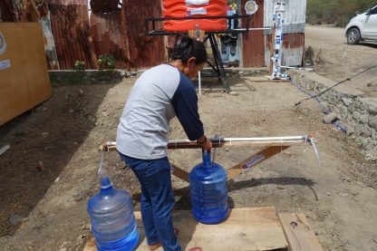 resident collects water after