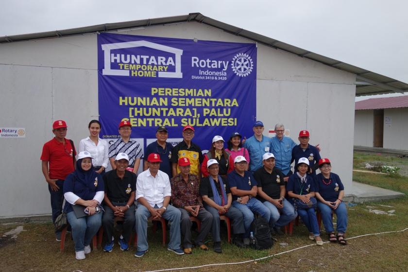 Rotarians celebrate Huntara complete.JPG
